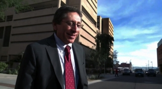 Juan Martinez picks his tie to match a cinematic sky